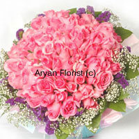 Think grand! Think big! This huge bunch is created out of 100 pink roses. A round arrangement of pink roses in full bloom is surrounded by seasonal fillers of different colours and green leaves. The look is finished with a wrapping paper around the flowers and a ribbon. Express your feelings of love and happiness with this bouquet. This one is sure to impress!