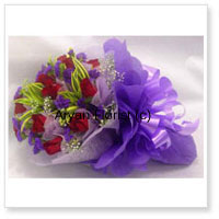 Bunch Of 12 Red Roses Beautifully Wrapped in Purple Paper With Seasonal Fillers