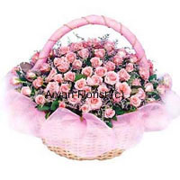 A Round Basket of 50 Pink Roses with Seasonal Fillers