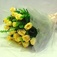 productEasily a sunshine bouquet, this one will surprise and spread light all around your loved ones and friends. Crafted with 12 fresh yellow roses, seasonal fillers, green leaves and fancy wrapping material, this bunch is simple and elegant. Choose it for expressing your warm wishes for friends, family or business associates. This bouquet will surely brighten the world a little.