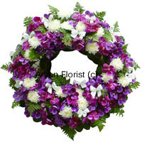productA delicate expression to wish eternal peace, this wreath is created with fresh flowers of various kinds. White, purple, pink and green gently embrace loving memories and offer condolence at a funeral or a prayer meeting.