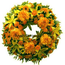 productA beautiful wreath made out of mixed flowers in yellow and orange. The flowers are fresh and handpicked and delicately placed. The flowers and greens are set in a classic arrangement that offer consolation during a funeral or a prayer meeting.