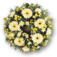 productThis gentle ring of white and yellow blooms will remind family and friends of all the fond memories. Gentle, soft and serene, the white flowers create a peaceful atmosphere. A lovely offering for condolence.