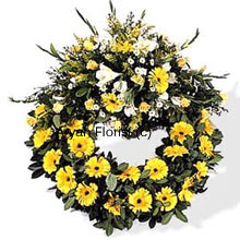 productPretty blooms in white and yellow are put together along with seasonal fillers and green leaves to create the most beautiful arrangement for offerings at a condolence meeting or funeral. Send this wreath to express your love, gratitude and condolence.