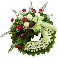 productThis wreath created with an assortment of flowers of various kinds, green leaves and ferns, is beautifully designed to offer heartfelt condolences in loving memory of a precious life. The flowers are fresh and handpicked, specially put together by experts. A ribbon bow on the arrangement makes it more beautiful.