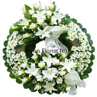 productThis wreath created with soft white flowers and green leaves is a lovely tribute to a lovely soul. Evoking fond memories of life, it is an expression of cherished emotions. Send your deepest condolences with this arrangement of sensitive white blooms.