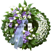 productThis wreath is designed with different flowers in white, cream and blue. It is a beautiful and unusual tribute to the precious life, which will be remembered forever. The flowers are handpicked and each flower is delicately placed. Embellishments of white ribbons add to the serene look.