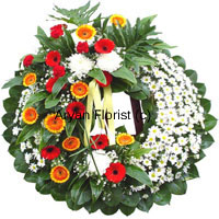productThis beautiful wreath created with colourful flowers will evoke memories of brighter days. It is specially designed by our expert florists and decorated with ribbons. The different flowers express different emotions in mourning.