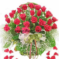 If beauty came in a basket there's only one way it would look. Just like this big basket of 30 red roses. Designed with seasonal fillers and green leaves in a pretty cane basket, this basket has a grandiose look. A perfect present for a wedding, birthday or anniversary celebration, this one is carefully designed to suit all occasions.