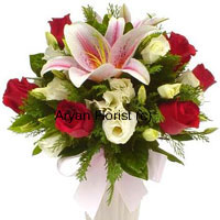 productLilies and roses are alluring enough, on top of that, the well thought choice of 'Red and White', roses and lilies add to the gravity of the colors. We know that mirth, joy and laughter go hand in hand, just like the this bunch of lilies and roses. Apt for all occasions, you may buy it especially as a departing gift. So embellish the time with this bunch so that you are obliged to meet again soon.