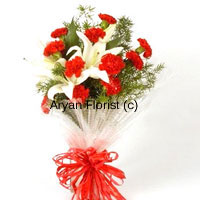 productThe most impressive arrangement of flowers to send anniversary wishes to friends, family or spouse, the bunch of flowers includes 10 carnations and 2 lilies along with fillers and embellishments. Our expert florists choose the best long stem flowers and design the bouquet with fancy wrapping and ribbons. Place it in a tall vase on any tabletop and it will change the mood of the space to celebratory.