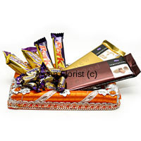 Sending only flowers? No time to buy gifts? This gift pack of assorted chocolates comes in handy and can be ordered along with the flowers. This accompaniment can be made on special days and festivals like Raksha Bandhan, Bhai dooj, Kid's Birthday's, welcome parties, house warming etc. Chocolates of good brands are sent along with the flowers, so be assured that the receiver will be pleased with this traditional way of showing care and fondness.