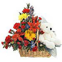 productSurprise your dear ones with not just flowers! This basket of assorted flowers gets delivered with a cute teddy soft toy. The flowers create a burst of bright colours and light up the atmosphere. Sweet smelling fresh blooms and buds are put together with green leaves and ferns in a pretty cane basket that can be easily placed on any tabletop or even hung by its handle. The teddy adds more sweetness to this gift.
