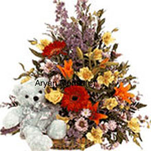 productAn absolute favourite, this basket full of fresh flowers gets delivered along with a soft teddy bear � a combo that's sure to brighten up your loved one's face. A variety of fresh seasonal flowers are put together by expert florists to create a drama of colour and fragrance. Flowers in red, yellow, orange and leaves and fillers in green fill the basket, while the teddy sits cute and cuddly by the side. This one's perfect for birthday and anniversary.