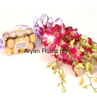 productFor those who go for the best, this combo of a bunch of orchids and a box full of 16 Pcs Ferrero Rocher chocolates is a matchless surprise. The orchids held together with a pretty satin ribbon bow make an elegant bunch to be placed on any tabletop and the chocolates add the element of sweetness. Order this for wishing friends and family or even professional associates.