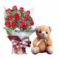 An abundant bouquet with 12 red roses and a small cute teddy bear, this combo absolutely brings a smile to anyone's face. The bouquet is designed with fresh red roses and fillers and wrapped with fancy wrapping. A satin ribbon add on completes the attractive look. The small teddy bear sits cutely by the bouquet. Send this present on birthdays, anniversaries and other occasions.