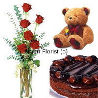 This absolutely amazing combo includes 6 roses in a glass vase, a 1/2 kg chocolate cake and a small teddy bear. Shower your special one with this combo. Red roses are elegantly placed in a simple glass vase, the chocolate cake is freshly baked by the best bakers in town and the teddy bear is overloaded with cuteness. Order this one for birthdays, anniversaries, as a welcome-back gift or any other special occasion.