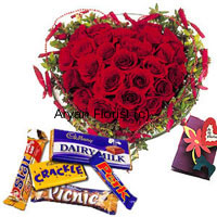 productWhat shouts love more than red roses? A heart-shaped bouquet of 40 red roses. If that's not enough, an assortment of chocolates and a greeting card along with the bouquet. Fresh red roses are stylishly decorated into a heart-shaped bouquet. Fillers, green leaves and decorative add ons and beautify it further more. The chocolates add sweetness and the greeting card carries your message. Order this for the special one.