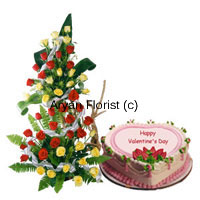 Send this impressive tall arrangement of a 100 red roses and a delicious 1 kg heart-shaped strawberry cake to your beloved. The tall arrangement of roses is delicately created along with fillers and leaves and stands impressively tall. Place it on the floor or a table and it will brighten up any space. The strawberry cake is freshly baked and packed with love.