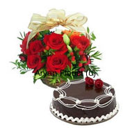productA fabulously special gift, this bunch of 12 red roses gets delivered with a 1 kg chocolate truffle cake. Fresh red roses gracefully bunch up along with green leaves and fillers in a basket that is decorated with fancy ribbon. A 1 kg chocolate truffle cake adds the element of sweetness. Send this to your friends and family to brighten up their day.