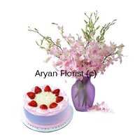 productAn enchanting combo of pretty orchids and a beautifully designed cake, gift this to friends and family on their special day. Fresh orchids are stylishly placed in a glass vase along with greens. The designer vase adds to the look of the arrangement. Accompanied by the orchids is a 1/2 kg strawberry cake, baked and designed by the best bakers in town. Order this and enchant everyone.