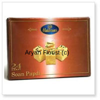 productThis Indian pack of sweets contain 1/2 Kg Soan Papdi, a cube shaped sweet having flaky texture and light weight. Crisp by form and served as flakes too tasting very sweet in nature. You may purchase it for yourself and gift it to your closed ones in family, relatives or so. Though it is enjoyed by all age groups yet mostly by the kids and youngsters as every place has its own way of making its sweets universal.