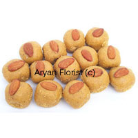 productPinni is a Punjabi and North Indian sweet items containing flour, almonds, ghee and jiggery made in s round shape. This pack weighs 1 Kg Pinni and is a special Indian delicacy that comes in variety. It can be presented in festivals, special occasions and cultural programs as per your choice. Celebrate your special days with family and dearest people around. Savor this sweet Pinni with smile on your lips and joy in your face.