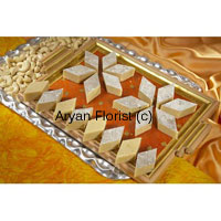 productThis pack contains 1 Kg Kaju Barfi in a Gift Box is available at a valued price to go for. Kaju Barfi also called Kaju Katli is beautifully arranged in place covered with silver foils wrapped in an eye catching gift box will surely make their day wonderful those are gifted with these special bundle of joy. This light sweet item can be gifted in several occasions and special days as India is a place of diverse festivals.