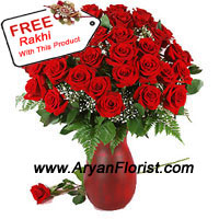 product40 bright red roses and seasonal fillers adorn a glass vase. A pretty Rakhi is delivered along with the flowers. Fresh roses are handpicked by expert florists and delicately put together in a pretty glass vase. The Rakhi is beautifully crafted with dainty embellishments, trinkets, and beads. The combo gets creatively wrapped and delivered with love.