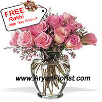 productKeeping it pink and elegant, this present combines 12 pink roses in a vase and a free Rakhi. Handpicked roses are delicately arranged in the vase along with fresh ferns. The Rakhi is a designed in a colorful traditional pattern. The combo symbolizes the special bond that brothers and sisters share. Send this adorable present to your brother on Raksha Bandhan and celebrate the festive occasion.