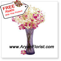 productA beautiful slender vase comes to you on this Rakhi with beautiful Orchids that are wonderfully arranged into it. Orchids are a reflection of power and on this Rakhi, you may show this to your little sister by giving her these flowers and prove your powerful love for her. The vase will constantly remind your sister of this beautiful gift and each time she will feel admiration towards you. Order these now, as it comes with a Rakhi that you can ask her to tie.