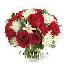 productThis Bouquet is an endearing way to extend warm wishes for this holiday season and display affection and admiration. The Rich red roses and spray roses that are arranged with white chrysanthemums, assorted Christmas greens, and eucalyptus. These are placed very beautifully in a round clear glass vase that acts as the foreground for these flowers. This superb arrangement spreads friendship and love and creates the festive spirit. So please your friends with this and celebrate together. (Please Note That We Reserve the Right to Substitute any Product with a Suitable Product of Equal Value in Case of Non-Availability of a Certain Product)