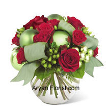 productWhen classic and contemporary get together, we get this beautiful bouquet to enhance the festivities and joy. The classic being the red roses and spray roses and the contemporary being bright green ornaments that elevate the appearance of this very elegant bunch. The arrangement comes in the white colored vase that further compliments the bouquet. Enjoy the very amazing festival with this par excellence arrangement that will indeed uplift your festive moods. (Please Note That We Reserve the Right to Substitute any Product with a Suitable Product of Equal Value in Case of Non-Availability of a Certain Product)