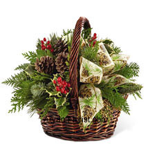 productAssorted holiday greens, variegated holly, natural pinecones, red berry picks and cinnamon sticks are stupendously put together for that aromatic welcome that each season looks forward to. Each natural green and flowers present in the basket signify the love and eagerness of a festive season. The aroma of the cinnamon recalls the winters and the celebration associated with it, making this arrangement an apt one! All this put together in a dark brown bamboo basket that is decorated with the Ivory holiday ribbon. (Please Note That We Reserve the Right to Substitute any Product with a Suitable Product of Equal Value in Case of Non-Availability of a Certain Product)