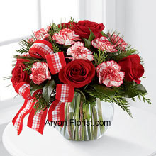 productThe waft of the season is symbolized through the fragrance of the Red Roses and the peppermint carnations. This brings the nostalgia of the previous year and allows one to indulge more than the last year. This lovely arrangement comes in a glass bubble bowl that is decorated with red and white ribbon to elevate the appearance of the entire arrangement. So place an order for this and welcome the season with grace. (Please Note That We Reserve the Right to Substitute any Product with a Suitable Product of Equal Value in Case of Non-Availability of a Certain Product)