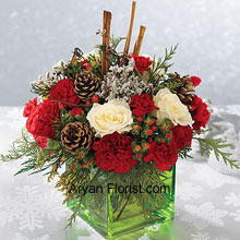 productThis affluent looking bouquet is indicative of your royal choice. This is indeed a breathtaking bouquet and has white roses, red carnations and Christmas greens that are absolutely perfect to wish your loved ones. The cinnamon sticks and pine cones are also a part of this lavish bouquet and spread beautiful aroma, apart from enhancing the beauty of the arrangement of flowers. All this comes in a uniquely shaped and tenacious glass cube bowl that holds this bunch of luscious flowers with ease. (Please Note That We Reserve the Right to Substitute any Product with a Suitable Product of Equal Value in Case of Non-Availability of a Certain Product)