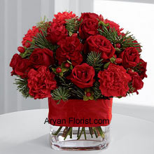 productRedness galore with these bright red spray roses, red mini carnations, burgundy mini carnations, red hypericum berries that fill your house with warmth and affection for each and every person who comes to wish to you on this holiday season. The redness is balanced very thoughtfully with the assorted holiday greens and all together they are arranged in a clear glass vase that is bedecked with a rich red ribbon. So gracefully celebrate your festivities with this lovely bunch! (Please Note That We Reserve the Right to Substitute any Product with a Suitable Product of Equal Value in Case of Non-Availability of a Certain Product)