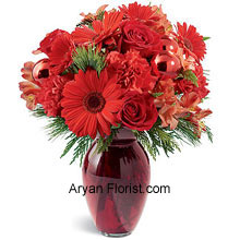 productRoseate colored vase with out of the world pretty crimson blossoms is perfect for the gift or for self too. The red Carnations, roses, Gerbera daisies, and alstroemeria are interwoven into this glazed vase that you will alter your idea of giving it away! This will tantalize your heart and will become one of the keep sakes in your list of vital festivity items. The holiday greens complement the entire range of reds and make it plush! (Please Note That We Reserve the Right to Substitute any Product with a Suitable Product of Equal Value in Case of Non-Availability of a Certain Product)
