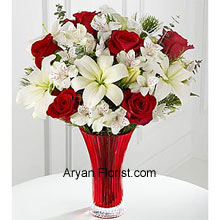 productThis bouquet is just like the reminder of the onset of the new holiday season for which we have eagerly awaited. The Red roses peep through the bunch of white Asiatic lilies and Peruvian lilies as if it is reminding the warmth that the snow brings with it. This is indeed a paradoxical bouquet of emotions and nature, placed in a red colored vase; telling that God is supreme! With a sense of gratitude and respect, buy this lovely bouquet. (Please Note That We Reserve the Right to Substitute any Product with a Suitable Product of Equal Value in Case of Non-Availability of a Certain Product)
