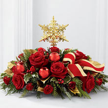productDecoration with dazzle, stars, flowers and much more is all in this season of Christmas. This centerpiece is a judicious mix of all these brought together in one. We present to you the Star, indicating the birth of a heavenly body and its presence in your abode and the rich red roses and spray roses surround the start like they are welcoming the coming of this divine body, on to this earth. This centerpiece is purely an exact replica that is behind the spirit of this season. (Please Note That We Reserve the Right to Substitute any Product with a Suitable Product of Equal Value in Case of Non-Availability of a Certain Product)
