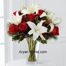 productBegin this season by buying Rich red roses that are mingled with white Oriental lilies. The assorted holiday greens and variegated holly stems that are placed in this arrangement are a sumptuous treat for the eye. Further put together in a clear glass vase, this arrangement is indeed a great way to wish season's greetings and best wishes. Why delay, place an order to wish others or for self, this will bring the season to a melodious start! (Please Note That We Reserve the Right to Substitute any Product with a Suitable Product of Equal Value in Case of Non-Availability of a Certain Product)