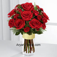productWhat Rich Red roses create, no other can!! To supplement your wishes, send this heartfelt collection of Rich red roses and spray roses that are offset by burgundy mini carnations, variegated holly stems, and assorted holiday greens. This pretty red arrangement is showing warmth, affection, and sentiments that are pure. This, arranged in a clear glass gold banded vase makes the festival even more special and memorable for the receiver and sender both. (Please Note That We Reserve the Right to Substitute any Product with a Suitable Product of Equal Value in Case of Non-Availability of a Certain Product)