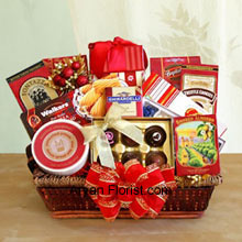 productIt is indeed a wonderful feeling when you receive a basket of chocolates and cookies to savor during tea time and at all happy times! So, gift this gourmet basket that can be presented on any occasion and savoured anytime. The basket is very well decorated with the lovely bow to enhance to the festivities and includes: Walker's holiday shortbread cookies, Ghirardelli chocolate assortment, Jelly Belly jelly beans, butter toffee pretzels, truffle cookies, cheese swirls, smoked almonds, cheese, English tea cookies, water crackers, and a Ghirardelli chocolate bar. (Please Note That We Reserve the Right to Substitute any Product with a Suitable Product of Equal Value in Case of Non-Availability of a Certain Product)