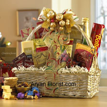 productHues of golden are often attractive, and so is this lovely off-white basket that holds superbly packed Dutch Gouda Cheese Biscuits, Crantastic Snack Mix, Chocolate Cocoa, Scottish Shortbread Fingers, Roasted Peanuts, assorted Godiva Dark Chocolates, Smoky Cheddar, Fancy Water Crackers, Swedish Ballerina Cookies, Holiday Mints, Bellagio Caramella Coffee, Christmas Tea, and non-alcoholic Sparkling Apple Cider in sparkling golden wrapper. This glittering golden packs of sweet and savory items are the best to indulge into on festive days. (Please Note That We Reserve the Right to Substitute any Product with a Suitable Product of Equal Value in Case of Non-Availability of a Certain Product)