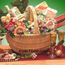 productThe magnitude of this basket, is as large as that of your relationship with your sibling. This elegant basket with lots of goodies will entice your sister/brother. The basket contains Starlite Mints in a Happy Holidays theme bag, 4 oz. Butter Toffee Pretzels, 3 oz. Peanut Butter Filled Delights, 3 oz. Caramel Filled Holiday Chocolates, Sara Sweets Box of Holiday Sugar Plums, 3.75 oz. Old Fashioned Chocolate Walnut Fudge, Old Fashioned Peanut Brittle, 2.25 oz. Peppermint Bark Bar, 4 oz. Old Fashioned Holiday Ribbon Candies, 5 oz. Beef Salami, Wisconsin Cheddar Cheese Round, Costa 8 oz. Wheat Crackers, Grained Mustard, Dolcetto's Cream-Filled Pastry Roll Cookies, 8 oz. Holiday Blackberry Jam, Sparkling Apple Cranberry Cider, Gourmet Holiday Coffee Blend and Holiday Traditions Assorted Holiday Cocoa. (All these products are subject to availability and are replaced with goodies of equal value).