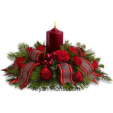 productWith the advent of the holiday season, this centerpiece is a wonderful way of showing your spirit of celebration. This comes with beautiful red carnations, with a pillar candle in the center. The special broad ribbon is well placed making the piece look like a Gulmohar flower that represents life and spirituality. This pretty centerpiece conforms to the occasion of spirituality and celebration together. This is definitely a harmonious way of celebrating and praying for the entire family. (Please Note That We Reserve the Right to Substitute any Product with a Suitable Product of Equal Value in Case of Non-Availability of a Certain Product)