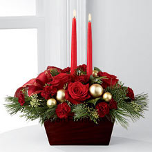 productSparkle is a stipulation of a festival of joy and merry making and the rich red roses and burgundy mini carnations conform to the spirit in a chorus. These are arranged in a trapezium shaped box that looks more than an arrangement of flowers, which are adorned with decorative red candles to keep up the significance of light on this festival. Demonstrating enlightenment and birth of Lord Jesus, this beautiful flower pack is pertinent to this occasion. (Please Note That We Reserve the Right to Substitute any Product with a Suitable Product of Equal Value in Case of Non-Availability of a Certain Product)