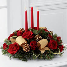 productThe beautiful beige embellishments with sparkling amalgamated flowers that look like the daisy, these Red roses shine bright and Burgundy among them. The assorted holiday greens and other assorted flowers along with variegated holly allow the red roses to be the shining armor to brighten your life on this holiday season. This enticing arrangement encircles the three red taper candles that keep the tradition of lighting candles alive, to enhance the festive spirit and holiday mood. (Please Note That We Reserve the Right to Substitute any Product with a Suitable Product of Equal Value in Case of Non-Availability of a Certain Product)